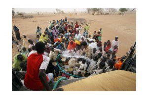 Civil war in the Darfur region of Sudan, 2003 to present. Gereida camp for displaced people, 2006. People wait in line for water distributed by the ICRC. There are more than 90,000 people in the camp. The ICRC provides water and relief items, as well as running a field hospital.
