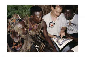Sierra Leone Civil War, 1991-2002. Between Bo and Kenema. An ICRC delegate explains the principles of international humanitarian law to militia fighters. Introducing fighters to the law of war and maintaining a bilateral dialogue with them to foster compliance is a key part of the ICRC's work.