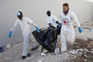 Morris Tidball-Binz (on right) evacuates bodies in Port-au-Prince, Haiti after the 2010 earthquake