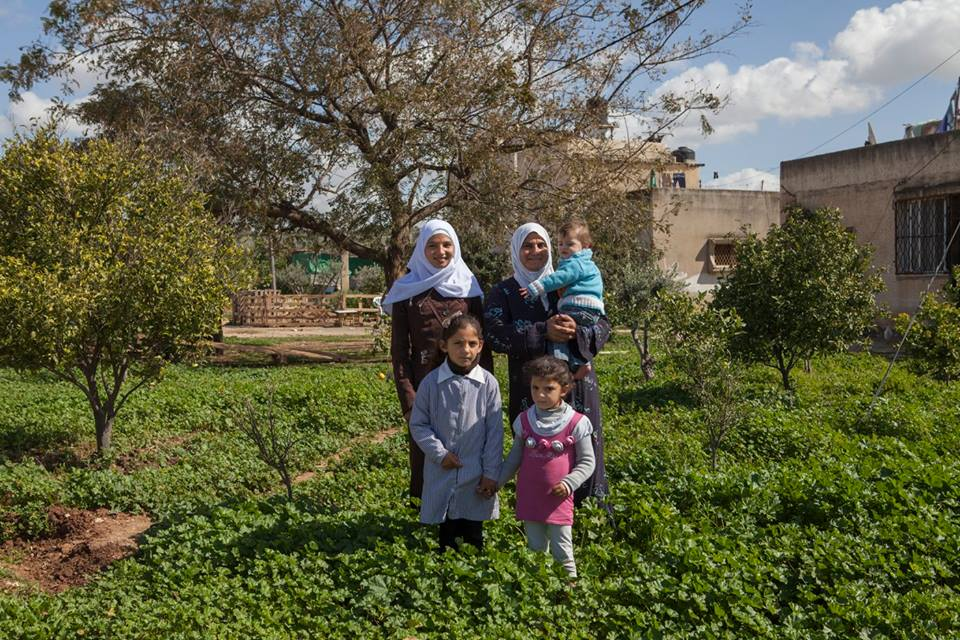 "Azzoun Atmeh, West Bank, 2015. Samaher and three of her daughters stand in front of their home. ""For over a decade, we were the only ones allowed to enter the enclave. After the checkpoints were removed, our whole family came to visit. Every day for a month, we received visitors, even people we didn't know!"" © ICRC / Andrea & Magda"