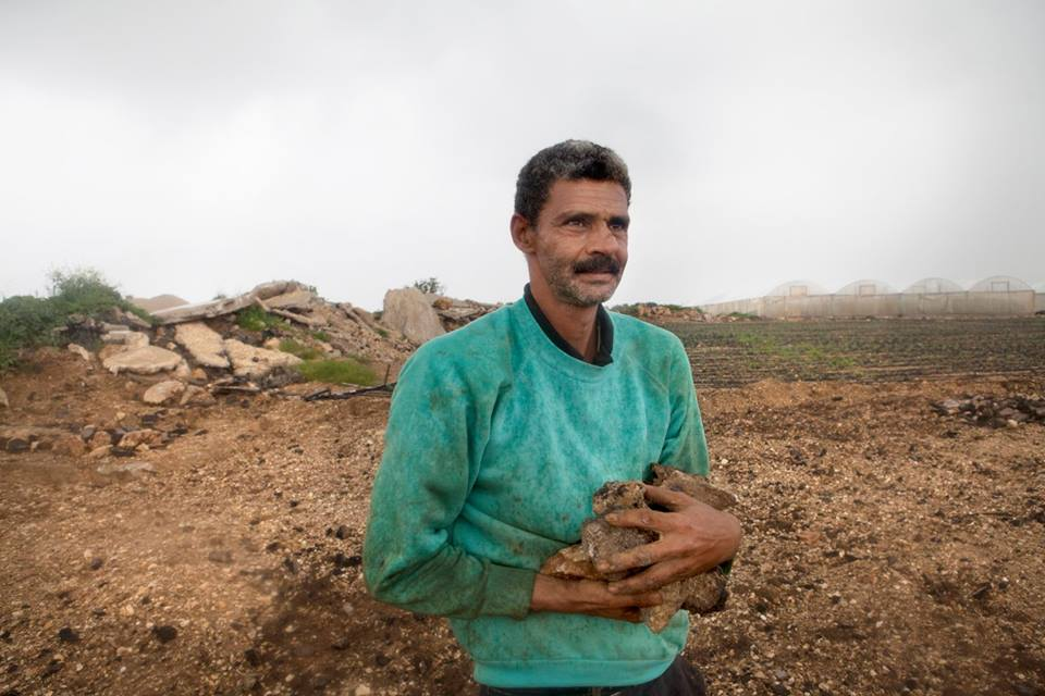 "Azzun Atmeh, West Bank, 2015. Samaher's husband Najy readies his land for planting. ""I can now get to my land freely and easily!"" Access to his fields had been particularly difficult as the fields were situated alongside a road frequently used by the military. After the nearby military base was moved, Najy spent months removing pieces of concrete and iron along with ammunition in order to cultivate the herb ""za'atar"". © ICRC / Andrea & Magda"