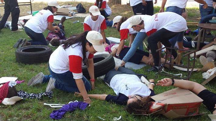 Responding and giving medical treatment during an Earthquake: dozens of youths participated in MDA unique training, which included working methods of the Red Cross Movement