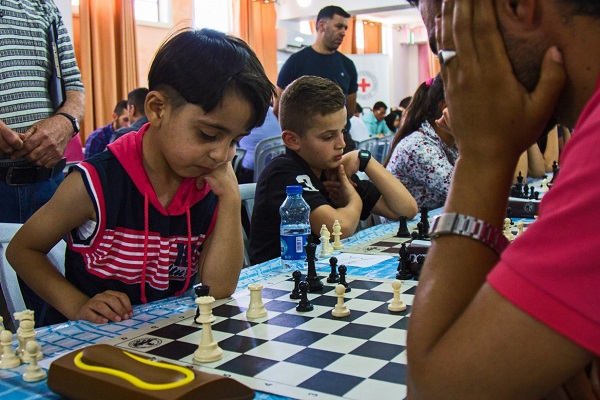 "Usaid Taki Al Deen Abed Al Baset from Hebron in the West Bank is 6 years old and has been playing chess for a year. ""I love chess because it helps me develop my mind, my time management skills and my patience,"" she said on 16 July, after winning one of the nine rounds of a chess tournament held in Al Jib, north-west of Jerusalem. ""I'm the champion in the 6-year-old category and I'm participating in an international chess competition in Dubai next week. I'm so happy to be representing the Palestinians in my category!"""