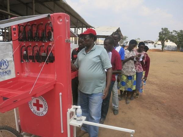 Caption: A Red Cross cellular charging wagon