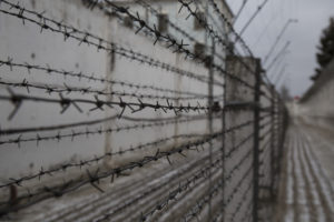 Dnipro, Ukraine, remand prison. A barbwire fence outside one of the prison blocks. Detention. ICRC. John Wendle