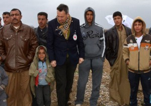 """During a January 2015 visit, Mr. Maurer (pictured wearing an ICRC badge) said he heard """"heartbreaking stories"""" from people displaced by fighting in Iraq. ©ICRC, S. Dabbakeh"""
