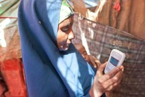 Fatuma checking phone for a message
